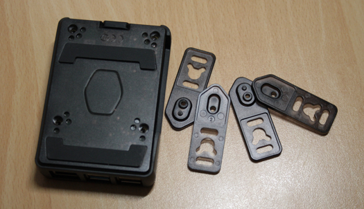 The base of the case along with the mounting arms